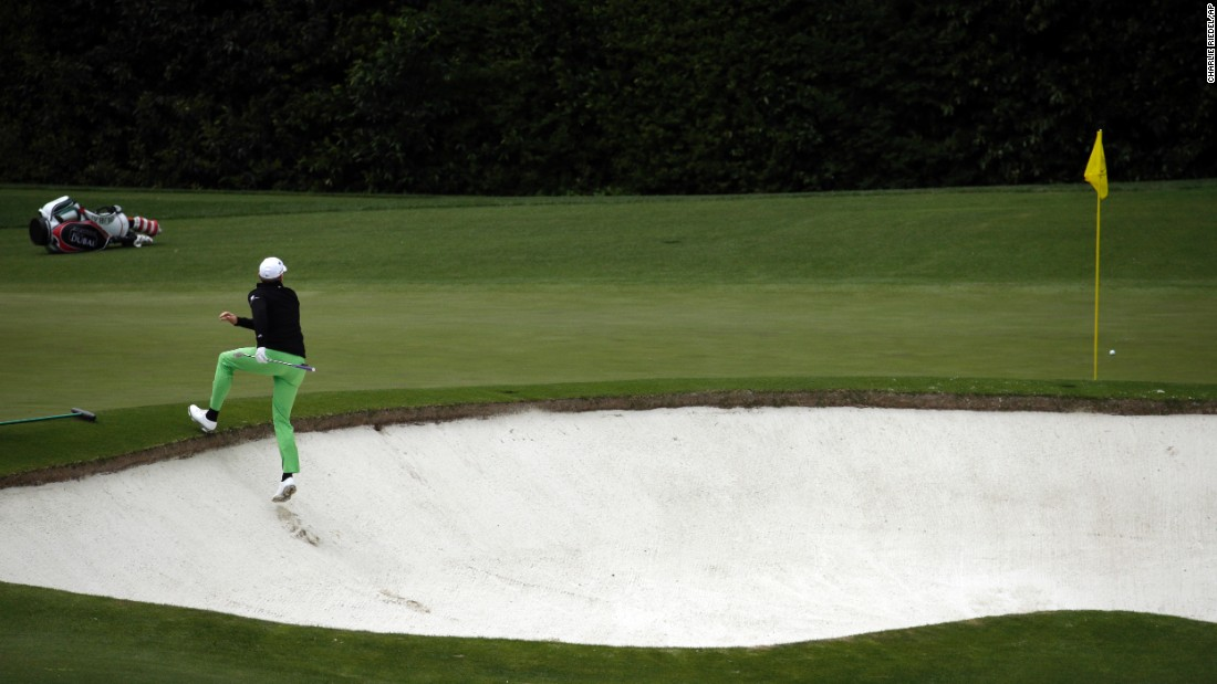 Jamie Donaldson climbs out of a bunker on the fourth hole Sunday.