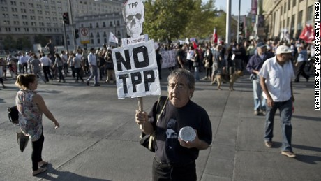 Members of social organizations demonstrate against the signing of the TPP free trade pact which aims to remove tariffs and other barriers to free trade between 12 Pacific Rim nations, in front of the presidential palace La Moneda, in Santiago, on February 4, 2016. The ambitious Trans Pacific Partnership (TPP) -- signed on Thursday in New Zealand -- aims to slash tariffs and trade barriers for an enormous 40 percent of the global economy -- but pointedly does not include Beijing.   AFP PHOTO / MARTIN BERNETTI / AFP / MARTIN BERNETTI        (Photo credit should read MARTIN BERNETTI/AFP/Getty Images)