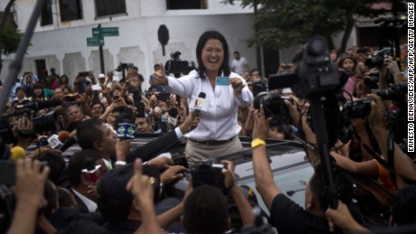 Peru´s presidential candidate, Keiko Fujimori, waves upon arrival at the voting station during general elections, in Lima on April 10, 2016  Almost 23 million Peruvians in Peru and abroad are expected to decide whether Keiko Fujimori, daughter of an ex-president jailed for massacres, should become their first female head of state in an election marred by alleged vote-buying and guerrilla attacks that killed four. / AFP / ERNESTO BENAVIDES        (Photo credit should read ERNESTO BENAVIDES/AFP/Getty Images)