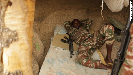 A Cameroonian soldier escapes the mid-day heat at border outpost.