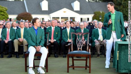 Willett commiserates with Jordan Spieth after receiving his green jacket from the defending champion.