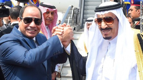 Saudi King Salman (R) shaking hands with Egyptian President Abdel Fattah al-Sisi before leaving Cairo's international airport on April 11, 2016.