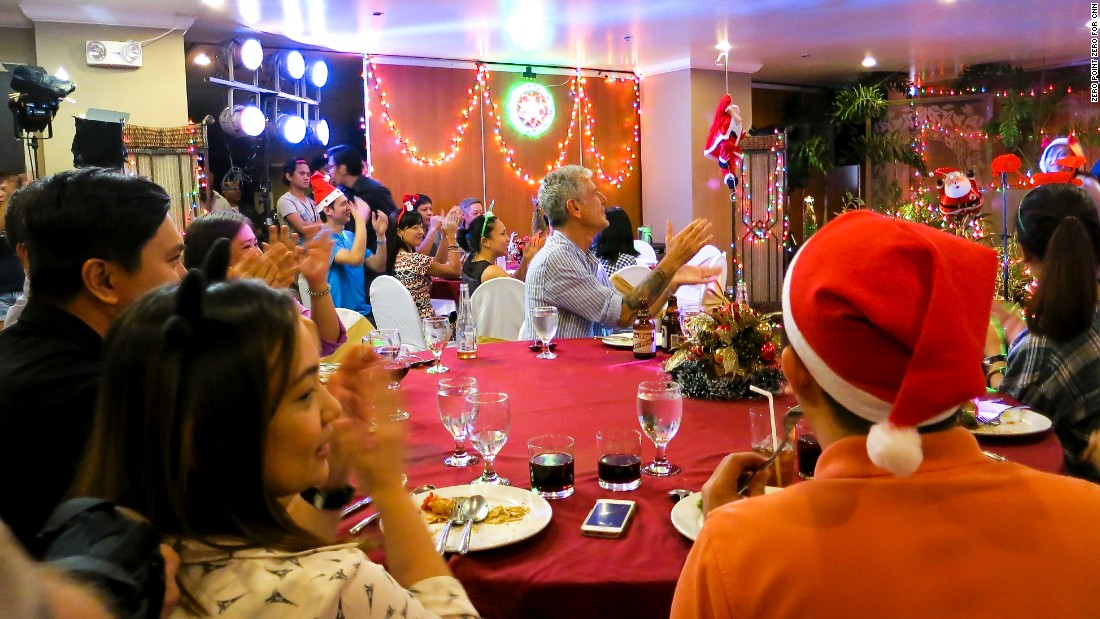 With a population that's more than 80% Catholic, Christmas is a very big deal in the Philippines. To get into the spirit, Bourdain attended a holiday office party in Manila.