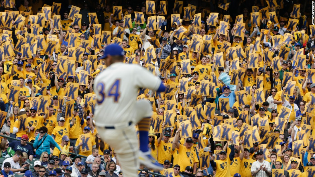 "Seattle baseball fans hold up signs for pitcher Felix Hernandez as he winds up for a pitch on Sunday, April 10. The ""K"" stands for strikeout in baseball terminology."