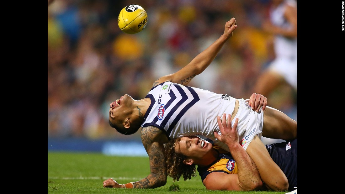 Matt Priddis of the West Coast Eagles tackles Michael Walters of the Fremantle Dockers during an Australian Football League match in Perth on Saturday, April 9.