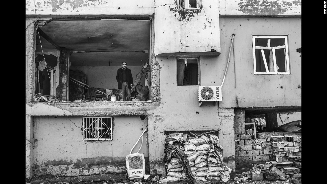 A man stands in his damaged home in Silopi, Turkey, in January.