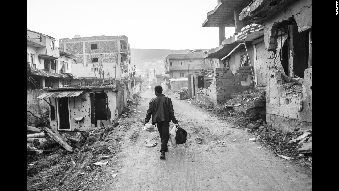 A man walks through Cizre in March.