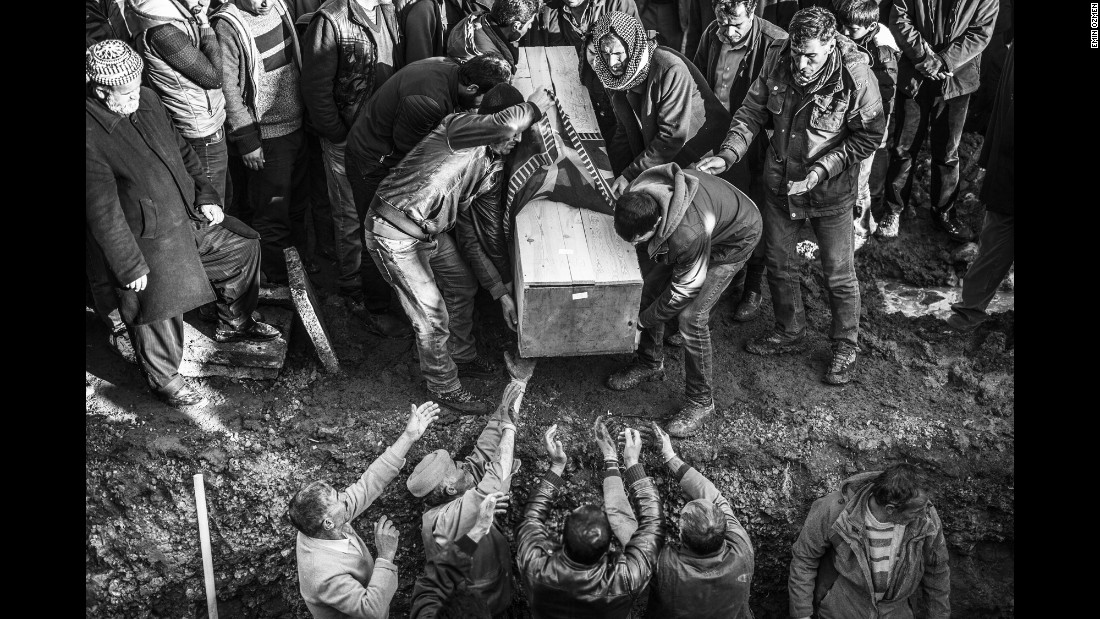 People bury a victim in Sirnak in January.