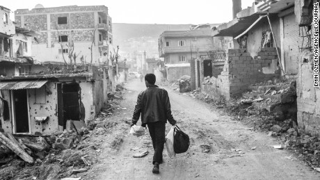 A man walks in the ruins of his city, Cizre. The city suffered a lot during the 78 days of curfew. The clashes between the turkish government and PKK rebels were very violent and left many homes in ruins. Cizre, Turkey, March 2016.