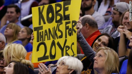 A fan pays tribute to Bryant's long career during Monday's game against Oklahoma City.