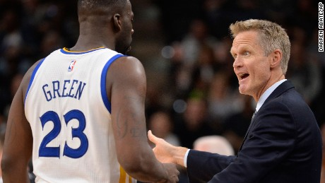 Golden State Warriors head coach Steve Kerr (right, talking to forward Draymond Green) was a member of the Chicago Bulls' 72-10 team in the 1995-96 season.