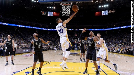 Curry, seen here April 7 against the Spurs at Oracle Arena in Oakland, California, leads the NBA in scoring with 29.9 points per game.