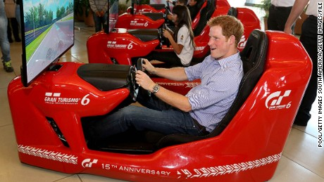 Royal racers: Prince Harry piloting an F1 driving simulator at the Ayrton Senna Institute, Sao Paulo, Brazil in 2014.