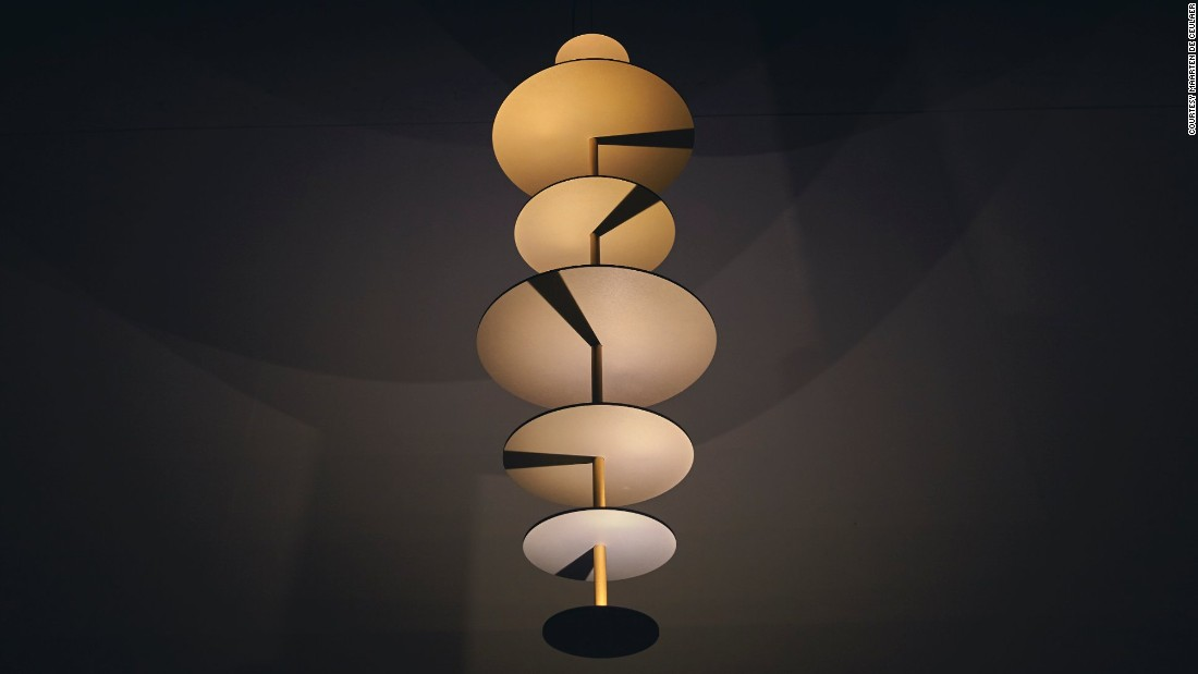 "Made of a series of anodized aluminum disks, <a href=""http://www.maartendeceulaer.com/"" target=""_blank"">Maarten De Ceulaer's </a> Sundial Chandelier's are aligned along a central rod. The rod's shadow is set to project in different directions, as if illuminated by different  suns, arranged in a spiral pattern as your eye travels down the disks."