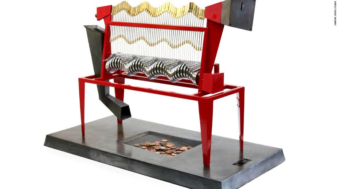"In a limited edition of just six, <a href=""http://www.smithautomata.co.uk/"" target=""_blank"">Martin Smith's</a> Cache Machine turns the traditional idea of a personal bank on its head. <br /><br />This incredible kinetic sculpture adds rhythm and interactivity to coin collection and, ironically, keeps the coins in open view. When a coin is inserted, it travels along a mechanically generated wave that ebbs and flows until it reaches its destination: a simple collection plate."