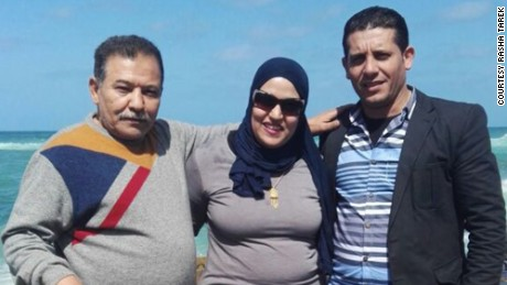 Rasha Tarek with her father, Tarek Abdel Fattah, and husband, Salah Ali.