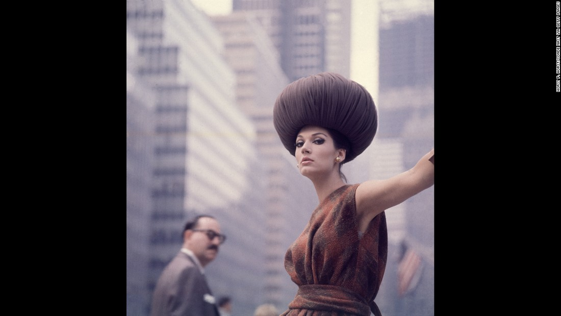 "A model wears a bulbous hat and a plaid, boatneck dress as she stands on a city street in 1962. Conde Nast teamed up with Getty Images to release the archival photos. ""We'd been after their content for some time. It's beautiful,"" said Bob Ahern, Getty's archive director. ""Fashion is cyclical, it draws so readily on inspiration of the past. To have these images available is amazing."""