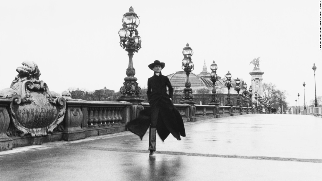 Model Chantal Dumont walks across the Pont Alexandre III, a Paris bridge, in 1969.