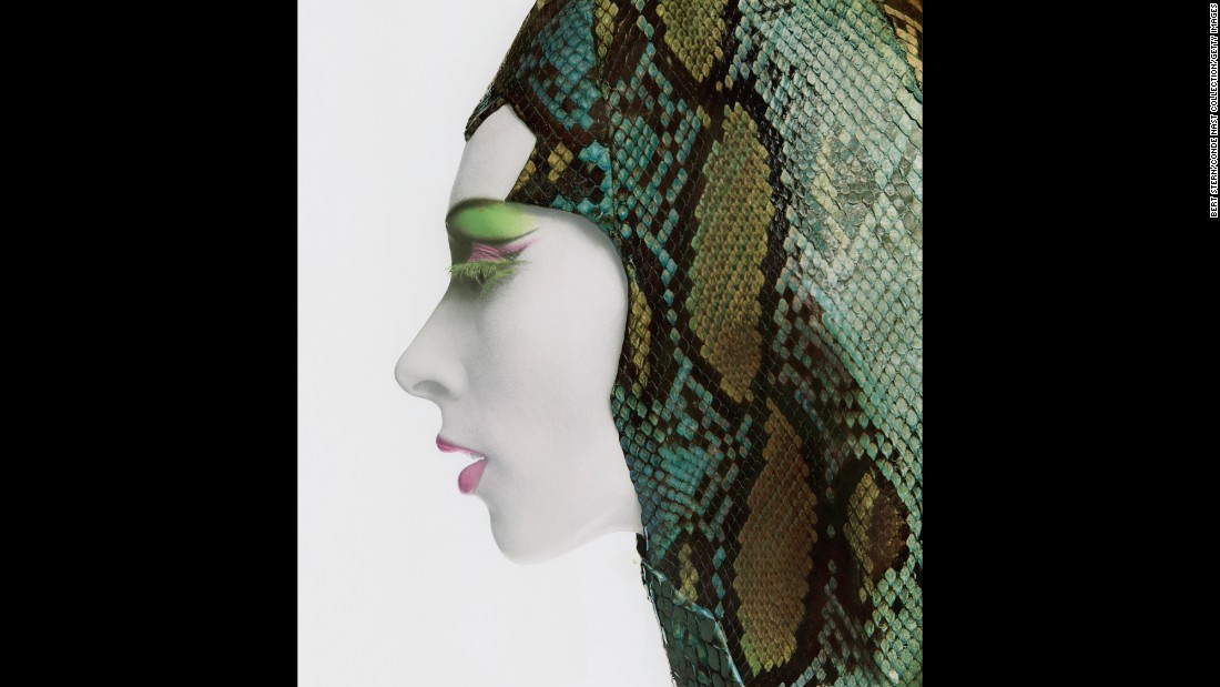 A model poses in a snakeskin hood in 1965.