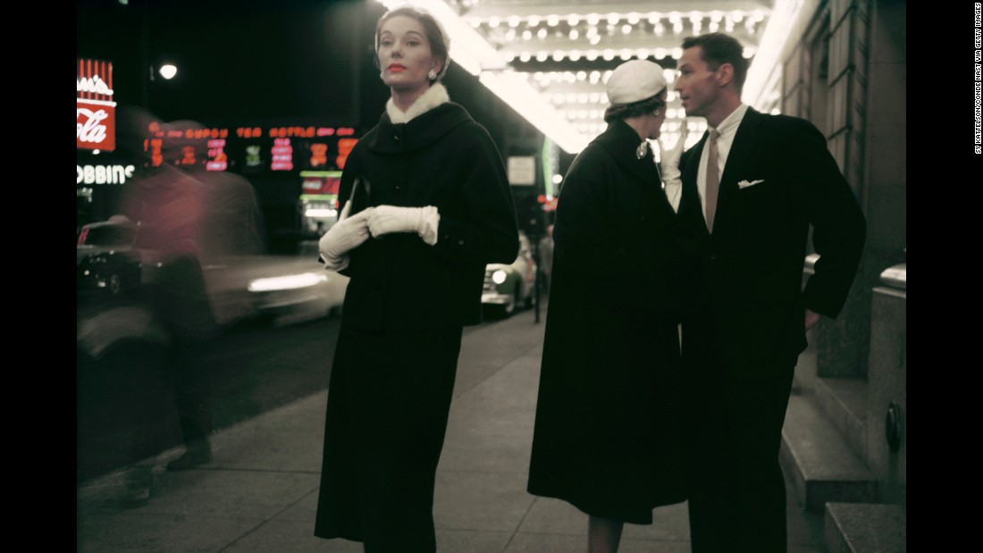 "Models stand beneath a theater marquee in 1954. ""This frame, from a fashion shoot by photographer Sy Kattelson, never ended up running in Glamour magazine as originally intended,"" Ahern said. ""Back in the day, the editors opted for a much more formulaic take with models fully posed and looking to the camera. But with a turn of a head and with a split-second of informality, this frame transgresses the fashion shoot and gives us an alternate moment of chic street-style elegance."""