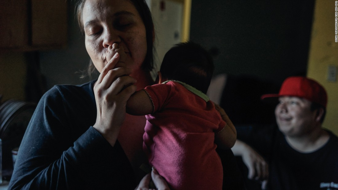 Inyan Pedersen, 34, holds her newborn daughter Sincere. Two of Inyan's younger children were born on a scheduled Cesarian, because the closest birthing center is two hours away.