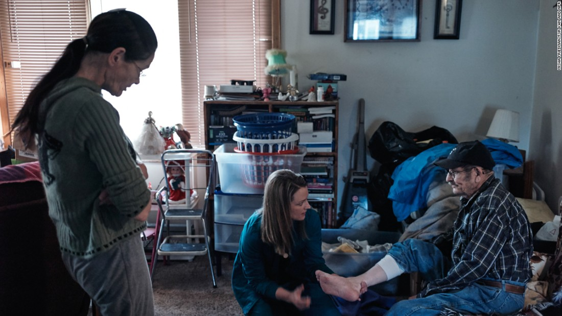 Larson examines Allen Marshall, 67, a home-bound patient with diabetes in Pierre, South Dakota.