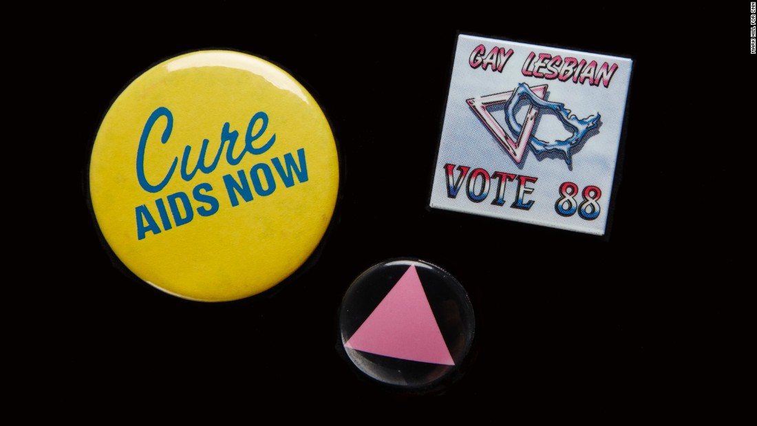 "The AIDS epidemic moved many people out of the closet and into the streets to fight for greater acceptance. Pins were an easy way to signal support. The pink triangle honored LGBT victims of the Holocaust and was a ""reminder of the Holocaust perpetrated by our governments refusing to deal with AIDS,"" said <a href=""https://books.google.com/books?id=d5_rAgAAQBAJ&pg=PA585&lpg=PA585&dq=the+time+is+not+right+to+march+on+washington+cathy+woolard&source=bl&ots=9SqK4h_lMo&sig=bEE1unMopqyn6ibfXFN1eyJxKDk&hl=en&sa=X&ved=0ahUKEwiigpGkrvjLAhXLQyYKHZgbAc0Q6AEIHDAA#v=onepage&q=the%20time%20is%20not%20right%20to%20march%20on%20washington%20cathy%20woolard&f=false"" target=""_blank"">Cathy Woolard in 1989.</a> Woolard, an Atlanta LGBT organizer, went on to be the Atlanta City Council's first female president. The buttons belonged to <a href=""http://emorymedicinemagazine.emory.edu/issues/2015/fall/features/aging-with-hiv/index.html#RHODES"" target=""_blank"">Richard Rhodes</a>, a Navy veteran and community organizer who became the first known gay candidate to run for the Georgia House in 1988, and was the first known gay delegate to the Democratic National Convention from Georgia. Every year on his birthday he would get an HIV test. AT 65, he tested HIV-positive. He remains an activist and an advocate for HIV testing."