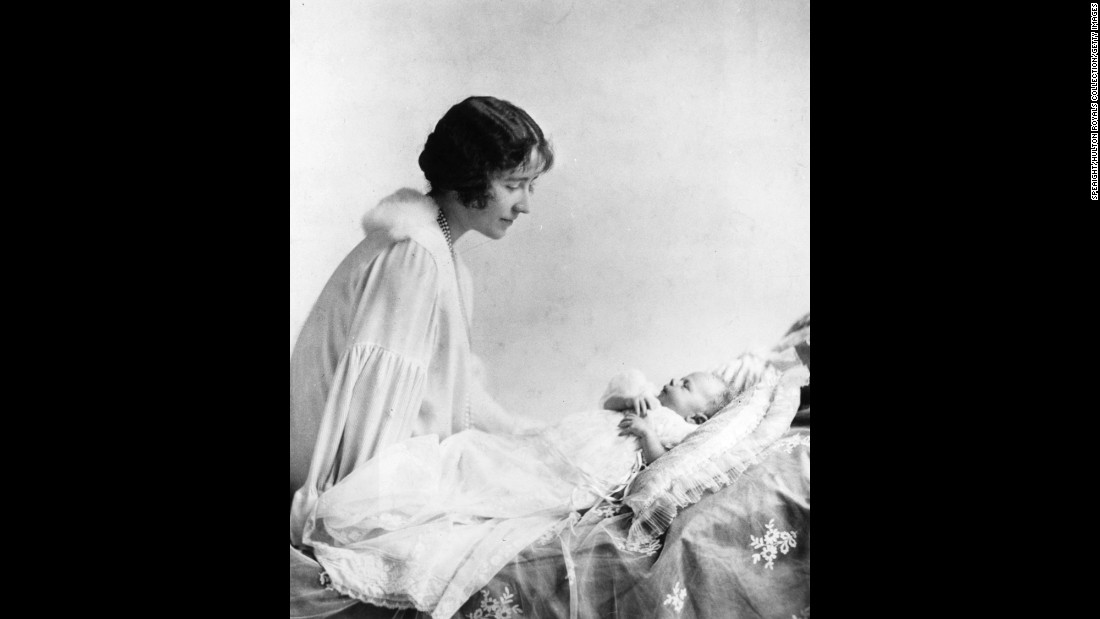The Duchess of York looks lovingly at her first child, Princess Elizabeth, in May 1926.