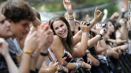 People listen to BB Brunes performing on stage during the Rock-en-Seine music festival on August 27, 2011, in Saint-Cloud, near Paris, France.  AFP PHOTO / JOHANNA LEGUERRE (Photo credit should read JOHANNA LEGUERRE/AFP/Getty Images)
