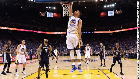 Curry led the NBA with 30.1 points per game this season and made a record 402 three-point shots.