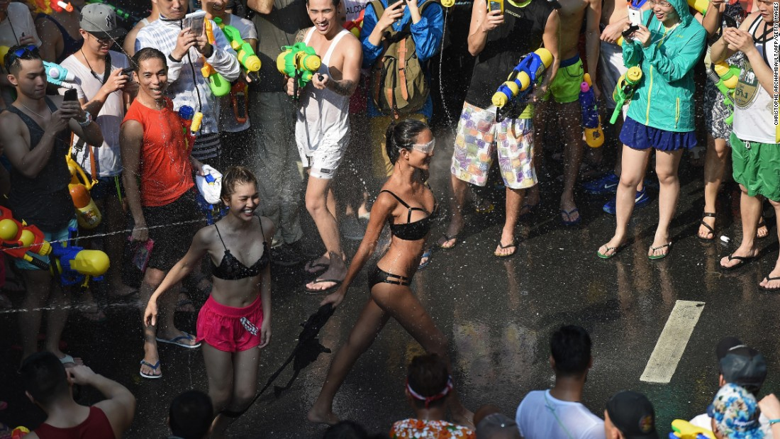 Revelers take to the streets in Bangkok for a water fight on April 13, 2016, the first day of the Songkran festival that marks the traditional Thai New Year.