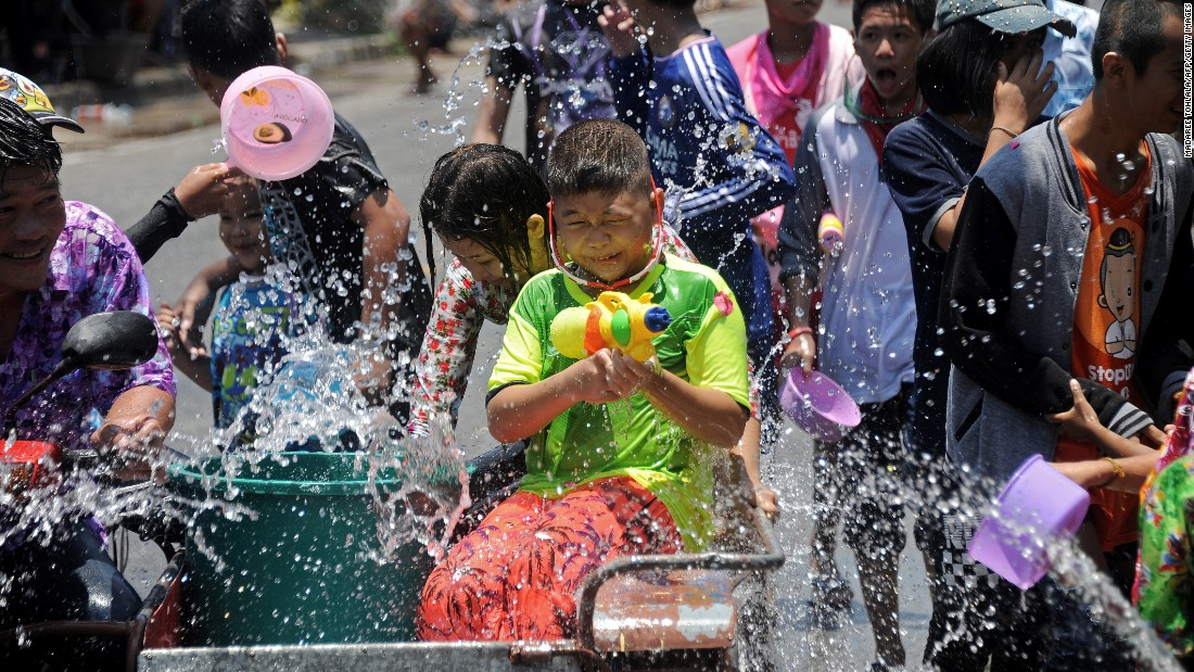 People drench each other in Thailand's southern province of Narathiwat on April 13.