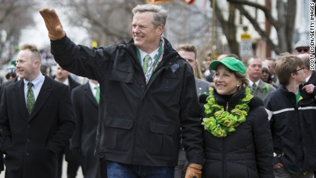 Gov. Charlie Baker of Massachusetts and wife Lauren Baker march in the annual South Boston St. Patrick's Parade passes on March 20, 2016.