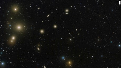 This new image from the VLT Survey Telescope (VST) at ESO's Paranal Observatory in Chile captures a spectacular concentration of galaxies known as the Fornax Cluster, which can be found in the southern hemisphere constellation of Fornax (The Furnace). The cluster plays host to a menagerie of galaxies of all shapes and sizes, some of which are hiding secrets.