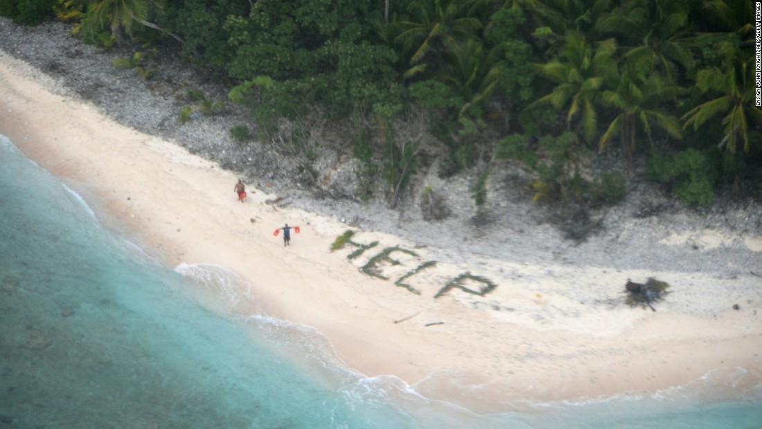 "A man waves life jackets next to a ""help"" sign made up of palm fronds in this photo released by the U.S. Navy on Sunday, April 10. The Navy and Coast Guard <a href=""http://www.cnn.com/2016/04/08/politics/castaways-rescue-help-sign/"" target=""_blank"">rescued three castaways</a> who had been stranded on Fanadik Island for three days. The remote Pacific island, part of the Federated States of Micronesia, is about 2,600 miles southwest of Honolulu."