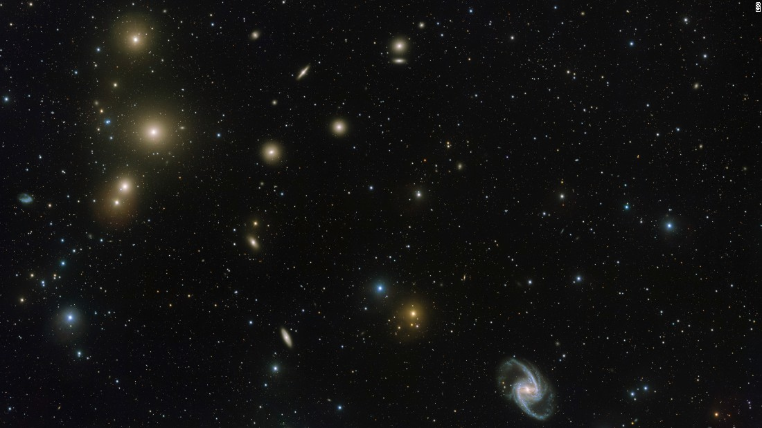 "This new image, released Wednesday, April 13, by the European Southern Observatory, shows a concentration of galaxies known as the Fornax Cluster. Astronomers estimate that the center of <a href=""http://www.cnn.com/2016/04/14/tech/cannibal-galaxies-photo-irpt/index.html"" target=""_blank"">the Fornax Cluster</a> is 65 million light-years from Earth. <a href=""http://www.cnn.com/2014/01/10/tech/gallery/wonders-of-the-universe/index.html"" target=""_blank"">See more wonders of the universe</a>"