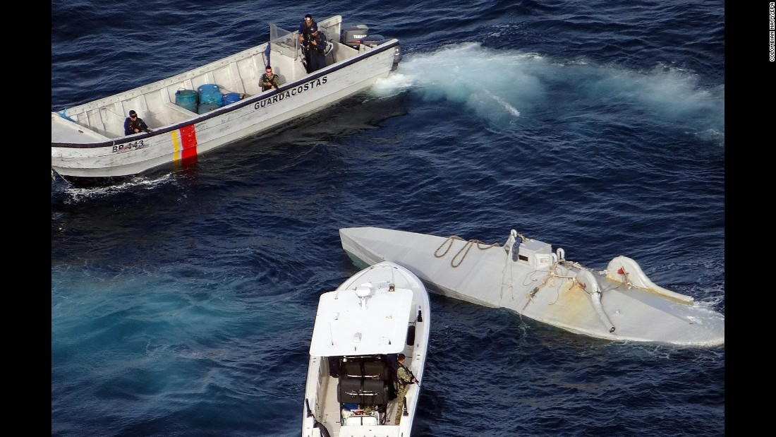 The Colombian Navy intercepts a submersible, right, that was carrying 6 tons of cocaine between Colombia and Ecuador on Wednesday, April 13.