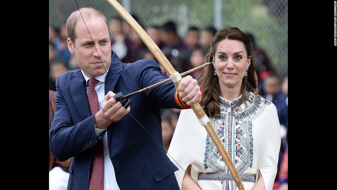 "Britain's Prince William fires an arrow as his wife Catherine, the Duchess of Cambridge, watches in Paro, Bhutan, on Thursday, April 14. She also got to take part in the archery demonstration. <a href=""http://www.cnn.com/2016/04/10/asia/gallery/royals-visit-india/index.html"" target=""_blank"">See more photos of the royal couple's trip to Bhutan and India</a>"