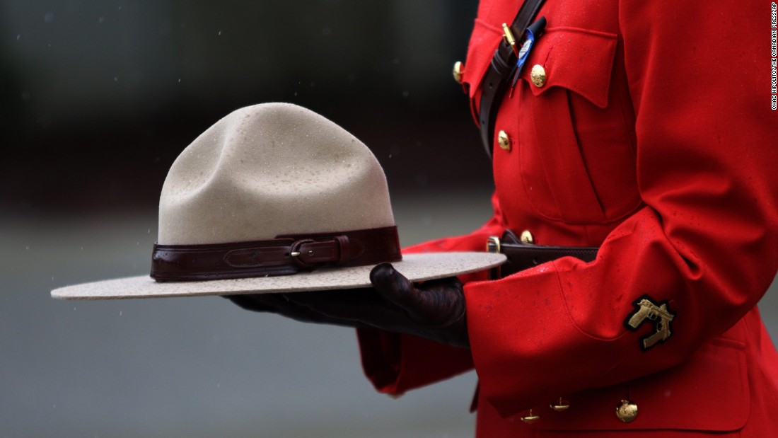 An officer with the Royal Canadian Mounted Police holds a hat during a funeral service for Const. Sarah Beckett on Tuesday, April 12. Beckett was killed when a pickup truck collided with her cruiser. She was 32.