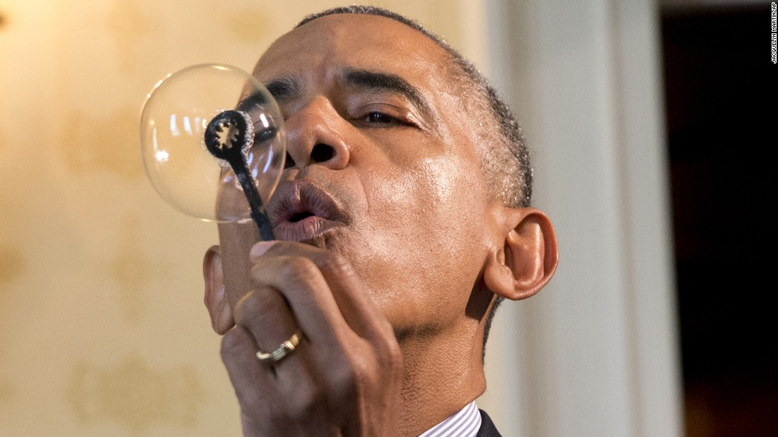 "U.S. President Barack Obama uses a 3-D-printed bubble wand, designed by 9-year-old Jacob Leggette, as he tours the <a href=""http://www.cnn.com/2016/04/14/politics/2016-white-house-science-fair/"" target=""_blank"">White House Science Fair</a> on Wednesday, April 13."