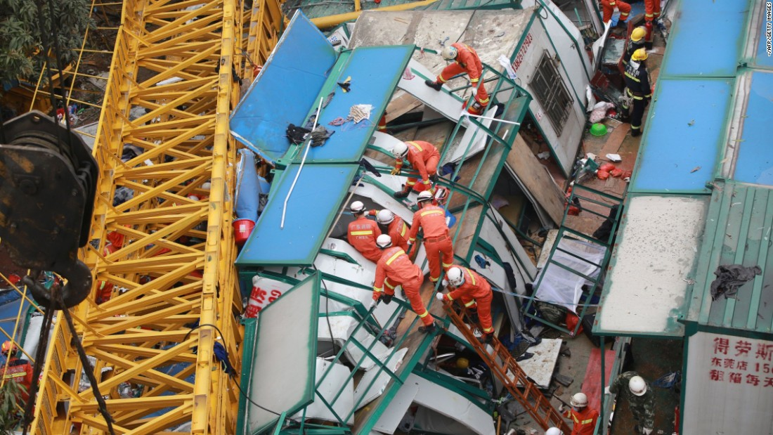 Rescuers in Dongguan, China, work at a construction site where a crane collapsed in high winds and killed at least 18 people on Wednesday, April 13.