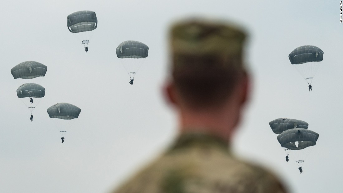 Parachutists land near Burglengenfeld, Germany, during a training exercise carried out by American, British and Italian soldiers on Tuesday, April 12.