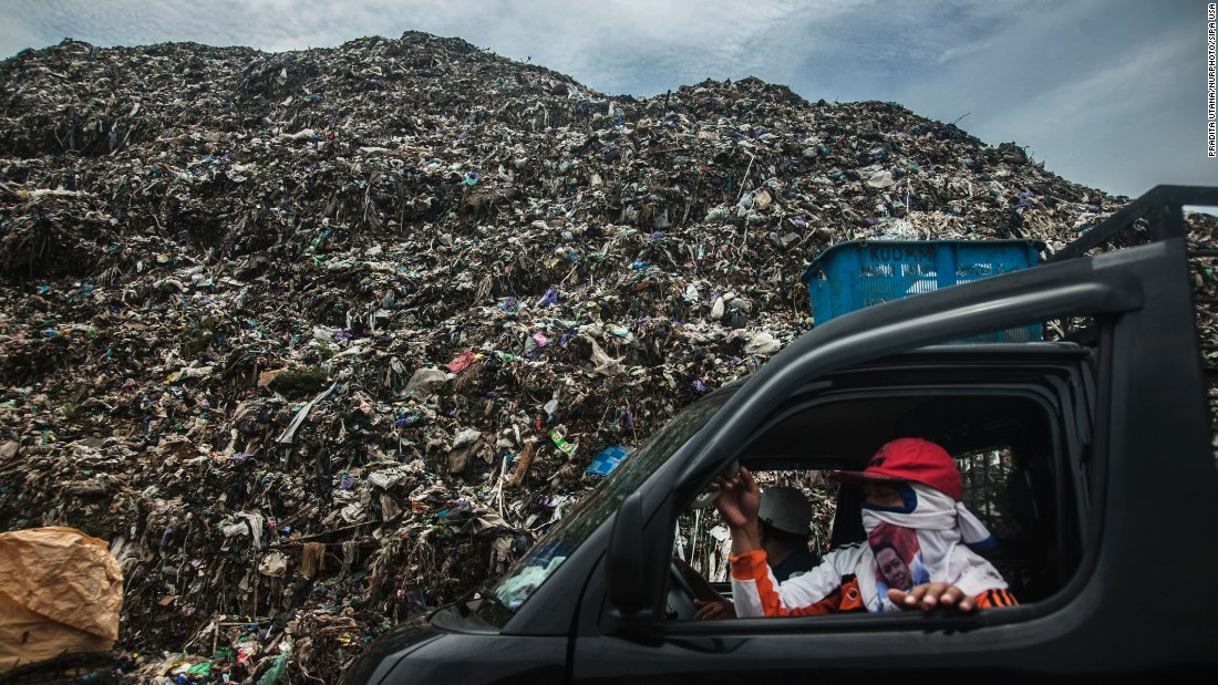 A scavenger picks up trash from the overloaded Degayu Landfills in Pekalongan, Indonesia, on Thursday, April 14.