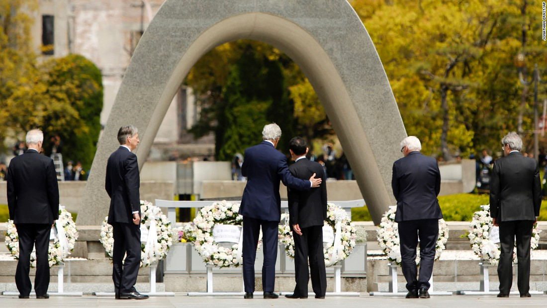 "U.S. Secretary of State John Kerry puts his arm around Japanese Foreign Minister Fumio Kishida after G-7 foreign ministers laid wreaths at the Hiroshima Peace Memorial Park in Hiroshima, Japan, on Monday, April 11. Kerry is <a href=""http://www.cnn.com/2016/04/11/politics/john-kerry-hiroshima-memorial/"" target=""_blank"">the first sitting secretary of state</a> to visit the memorial. <a href=""http://www.cnn.com/2016/04/08/world/gallery/week-in-photos-0408/index.html"" target=""_blank"">See last week in 33 photos</a>"