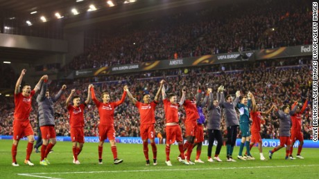 Liverpool players salute the Anfield crowd.