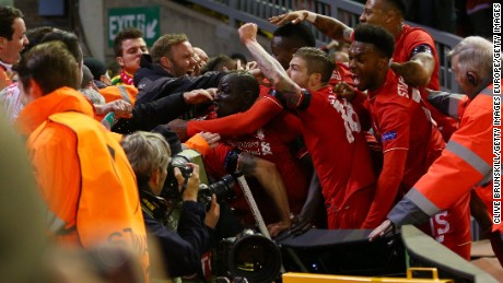 Liverpool players and fans mob Dejan Lovren after his crucial goal.