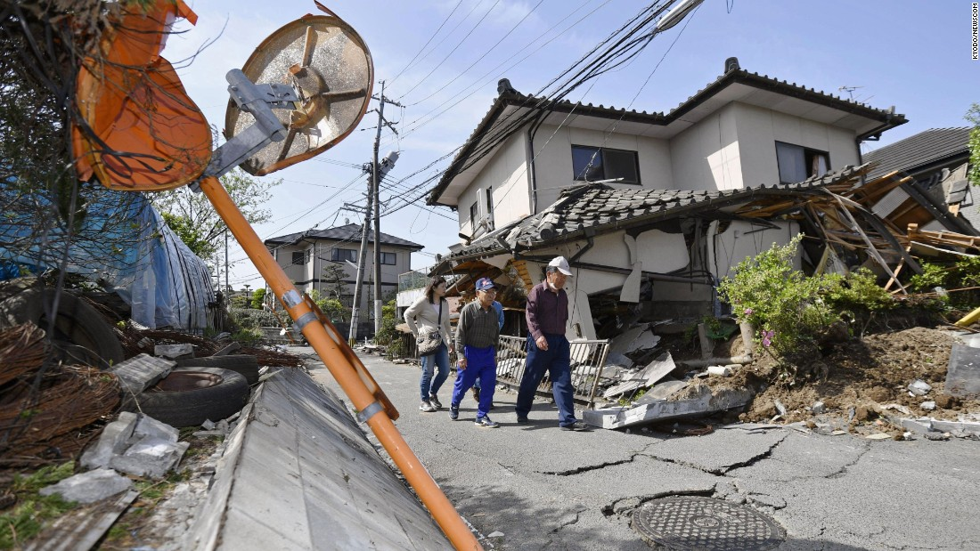 A house in Mashiki teeters after the quake.