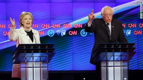 Democratic presidential candidates Sen. Bernie Sanders, I-Vt., right, and Hillary Clinton speak during the CNN Democratic Presidential Primary Debate at the Brooklyn Navy Yard on Thursday, April 14, 2016 in New York. (AP Photo/Seth Wenig)