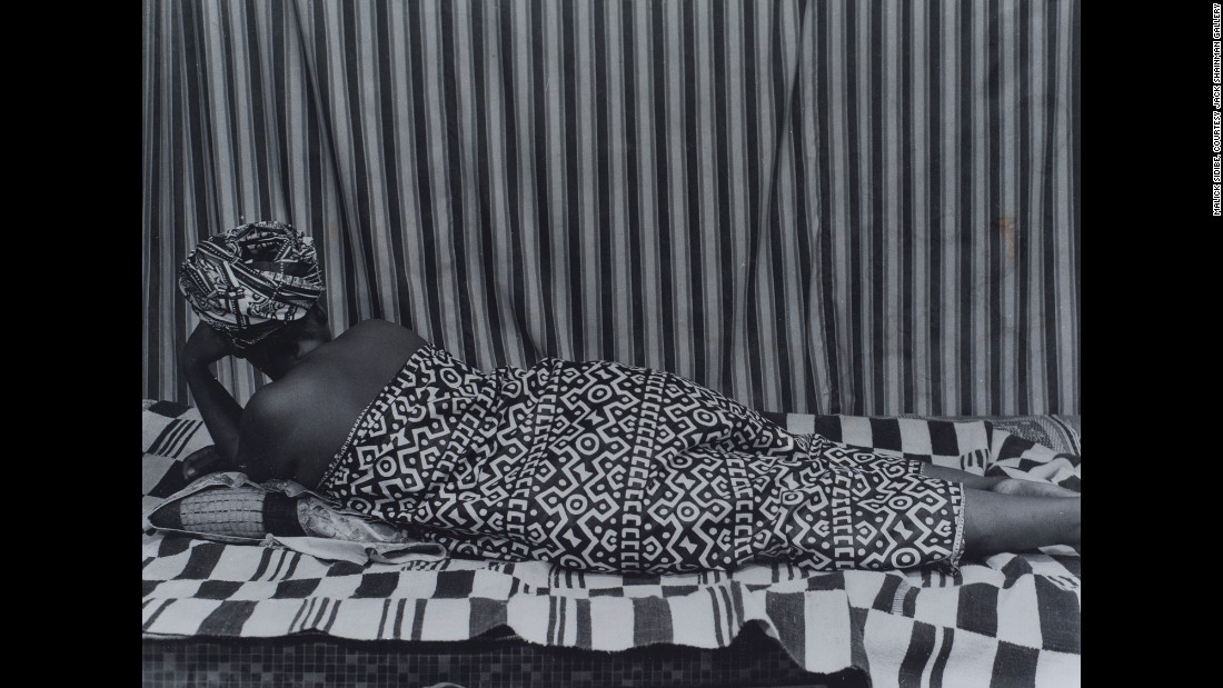 """The pioneering photographer's legacy lives on. Work spanning Sidibe's career is on exhibit at the <a href=""""http://www.jackshainman.com/exhibitions/20th-street/"""" target=""""_blank"""">Jack Shainman Gallery</a> in New York through April 23."""