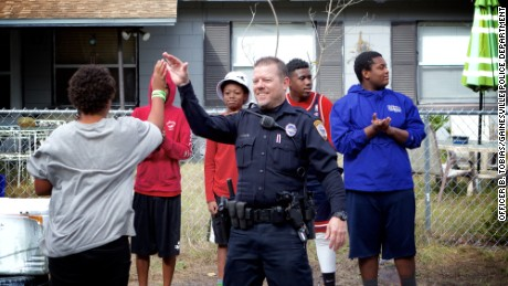 Officer White hopes the basketball courts in his city will become a model for the country.